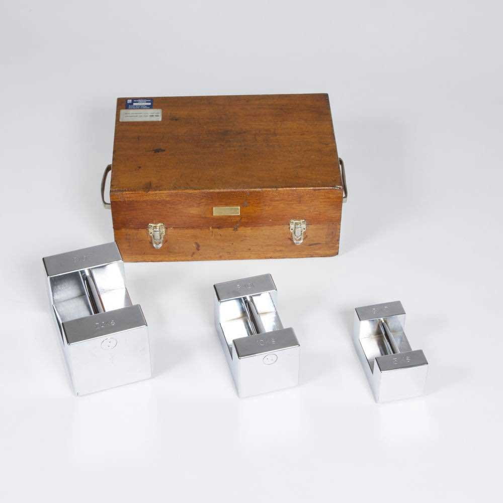 A CASED SET OF 3 WEIGHTS