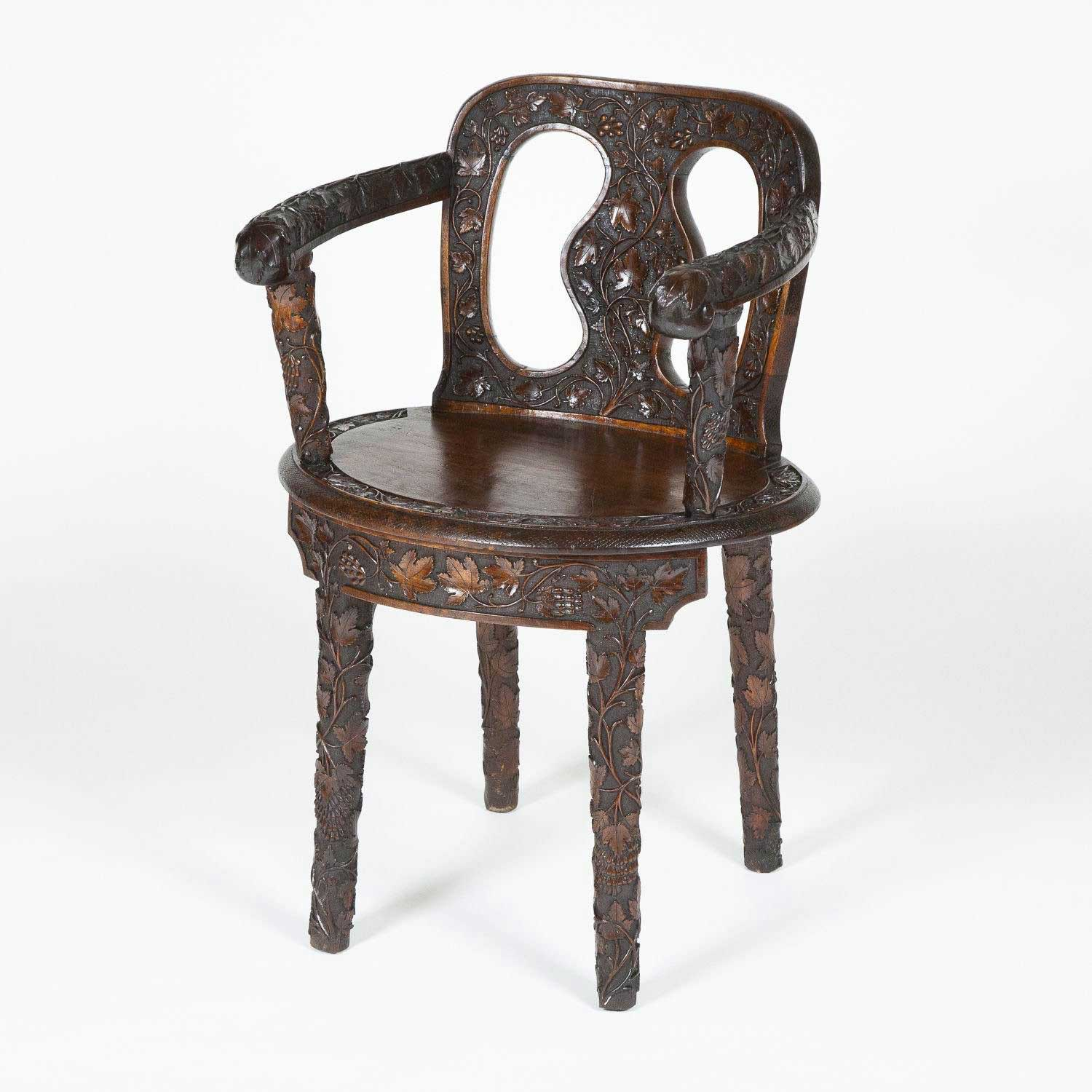 PAIR OF HALL CHAIRS CARVED WITH VINES